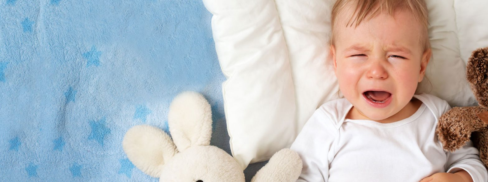 crying baby bed crib stuffed animal blue teething baby remedies vitafusion experience blog