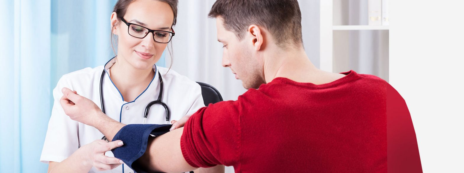female doctor glasses white coat stethoscope taking blood pressure cuff male patient red shirt back CoQ10 benefits vitafusion experience blog
